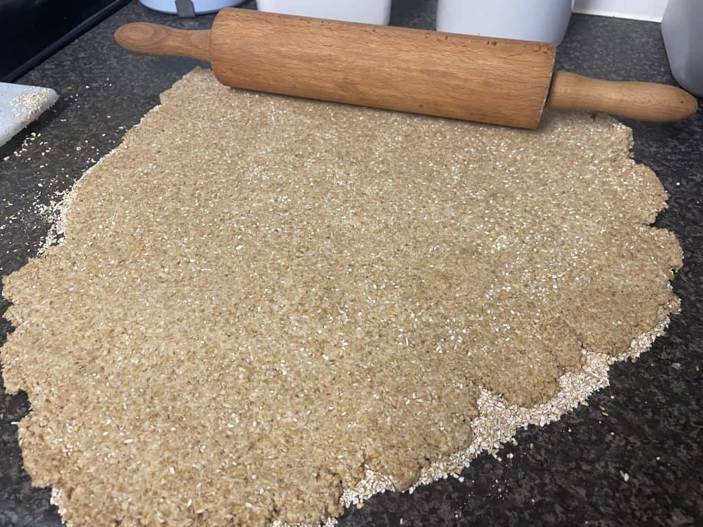 oatcake rolled out flat ready for cutting.