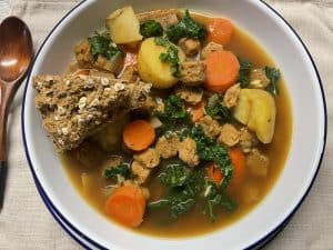 wedge of vegan Irish soda bread with Irish stew