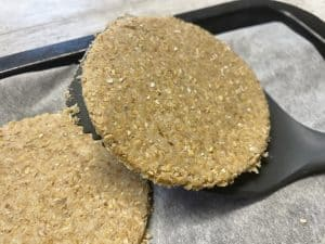 oatcake being scooped up with a spatula