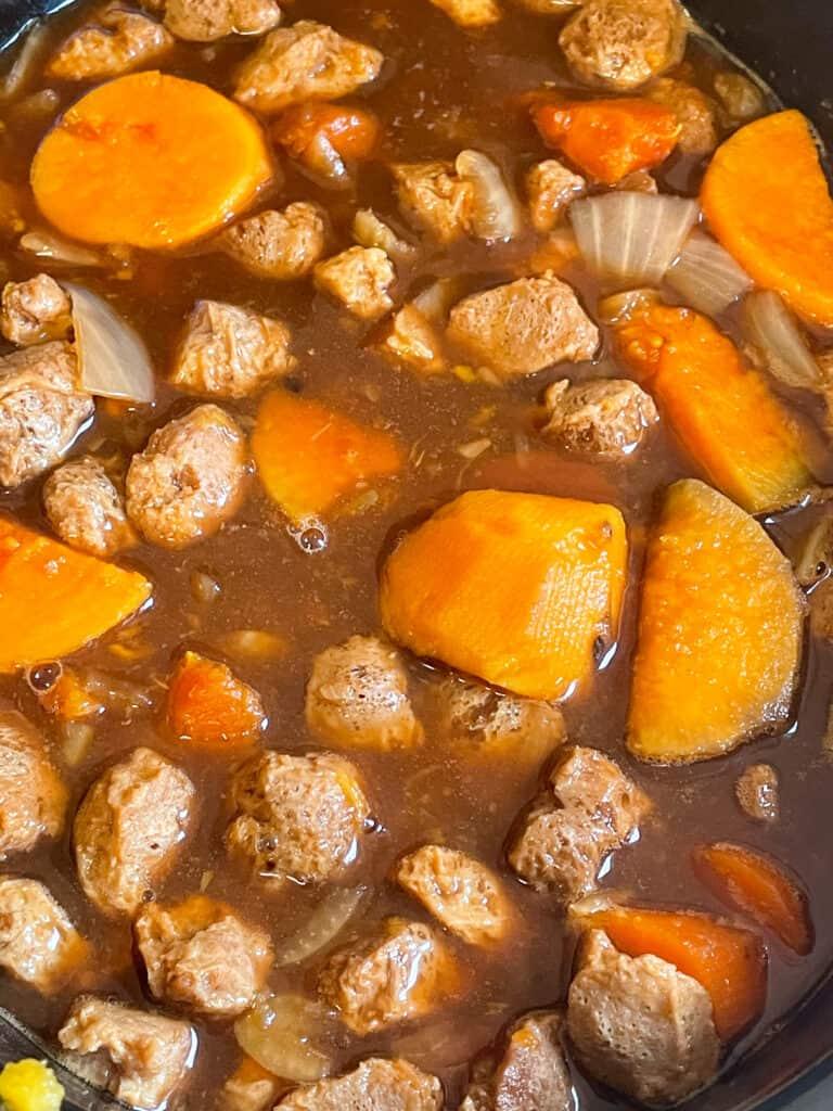 vegan beef stew cooking in slow cooker