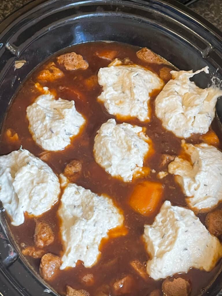 dumplings in slow cooker cooking in stew