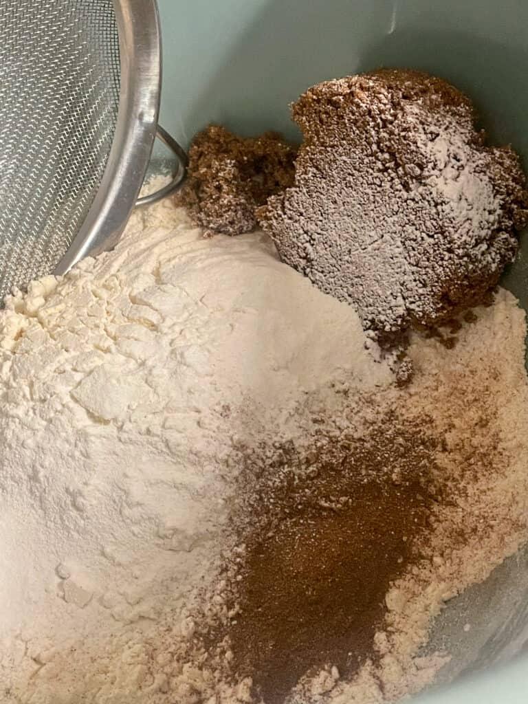 flour, sugar, cinnamon, baking powder in bowl.