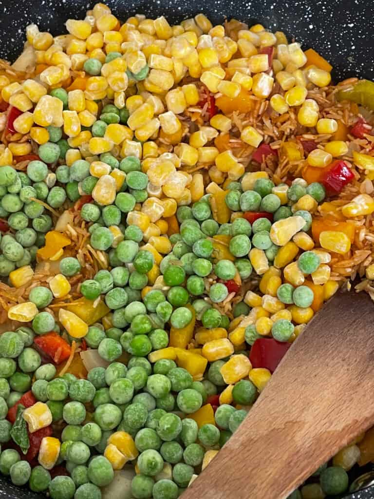 peas and corn added to pan