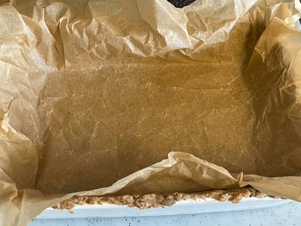 greaseproof paper added to uncooked pastry in baking dish.
