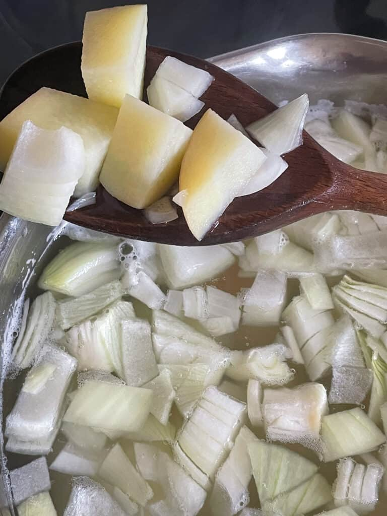 potatoes and onions prepared for cooking