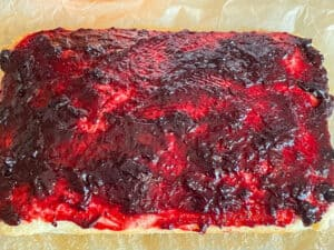 cake being spread with jam