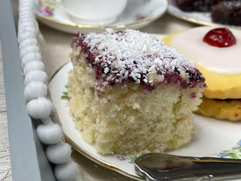 square of sponge cake on saucer.