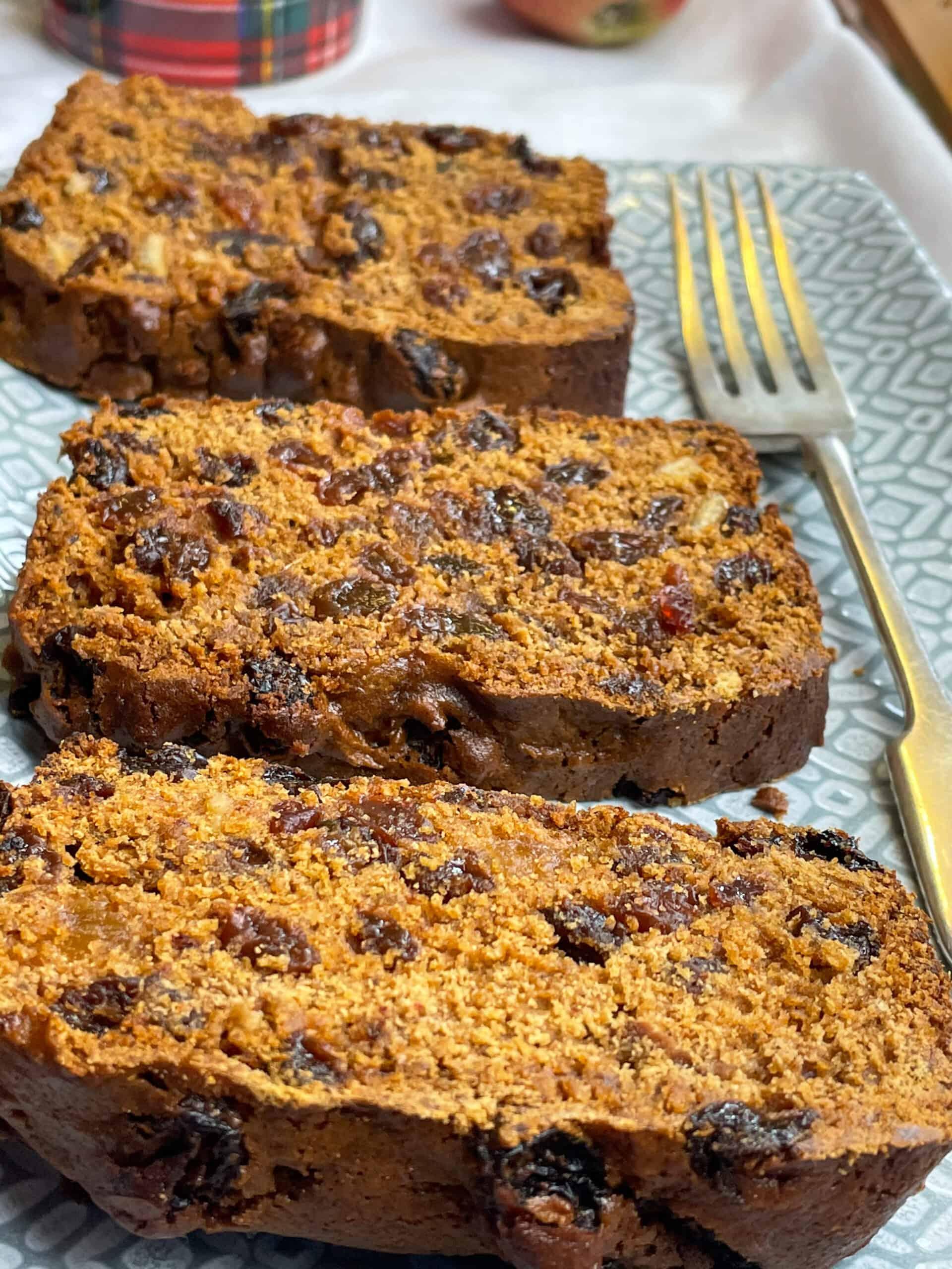 vegan fruit loaf cake on grey plate with fork