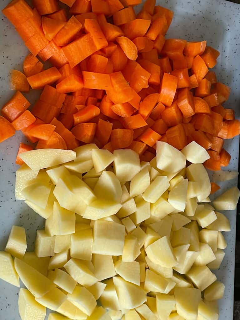 diced potato and carrot on chopping board