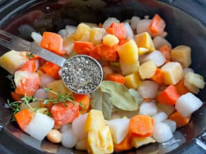 root veggies, bay leafs and mixed dried herbs in the pan