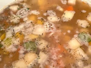 vegetable stock added to the pan