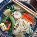 vegan stir fry soup in blue bowl with chop sticks