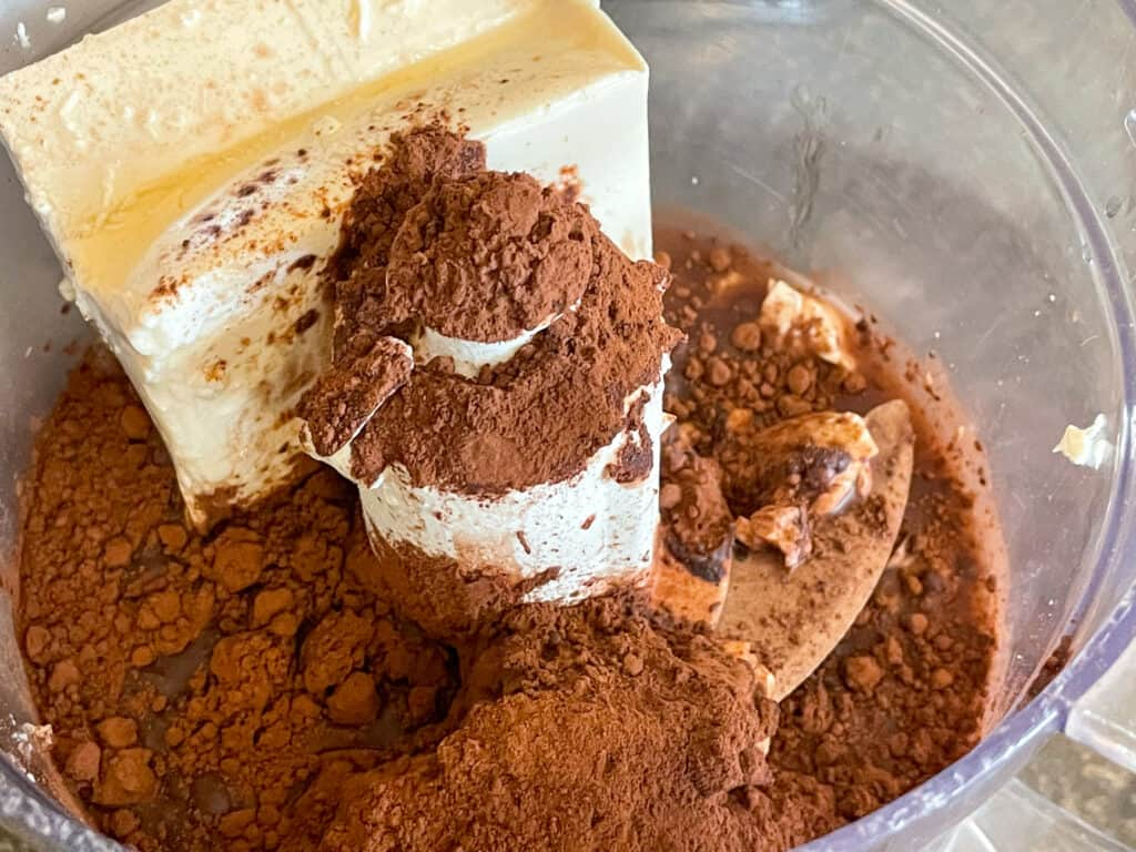tofu, cocoa powder, vanilla, maple syrup and water added to food processer.