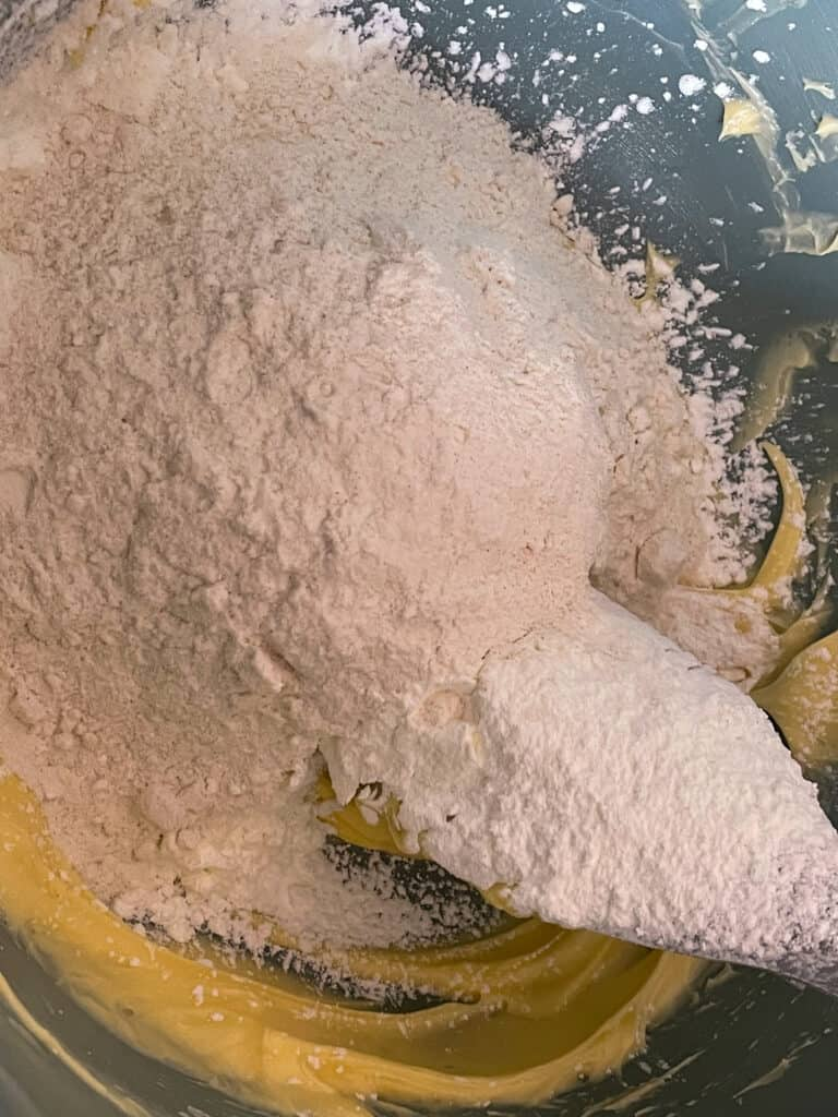 creamed sugar and margarine with added flour in a bowl.