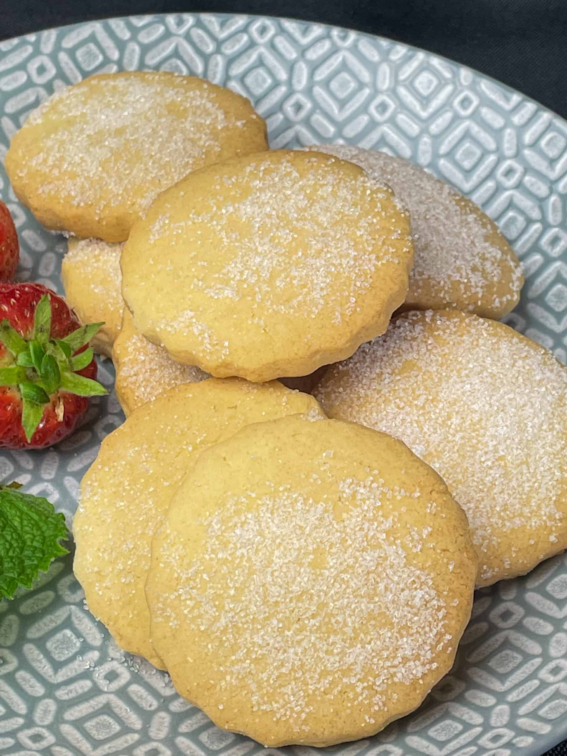 plate of shortbread biscuits on grey plate with strawberries