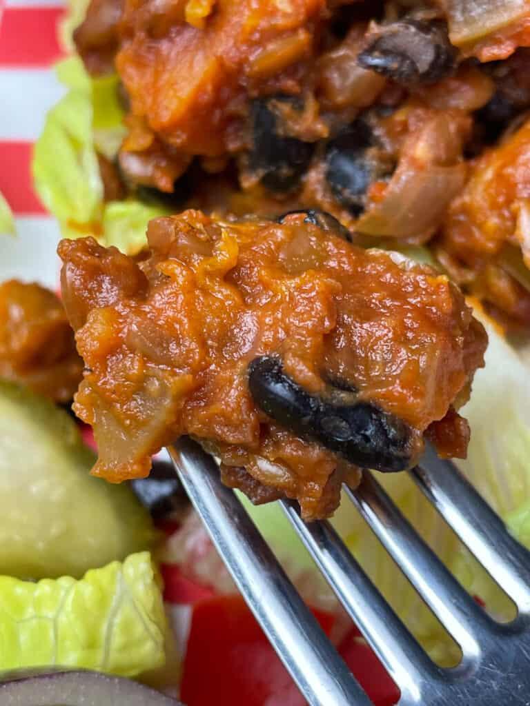 close up of a bite of sloppy joe on a fork.