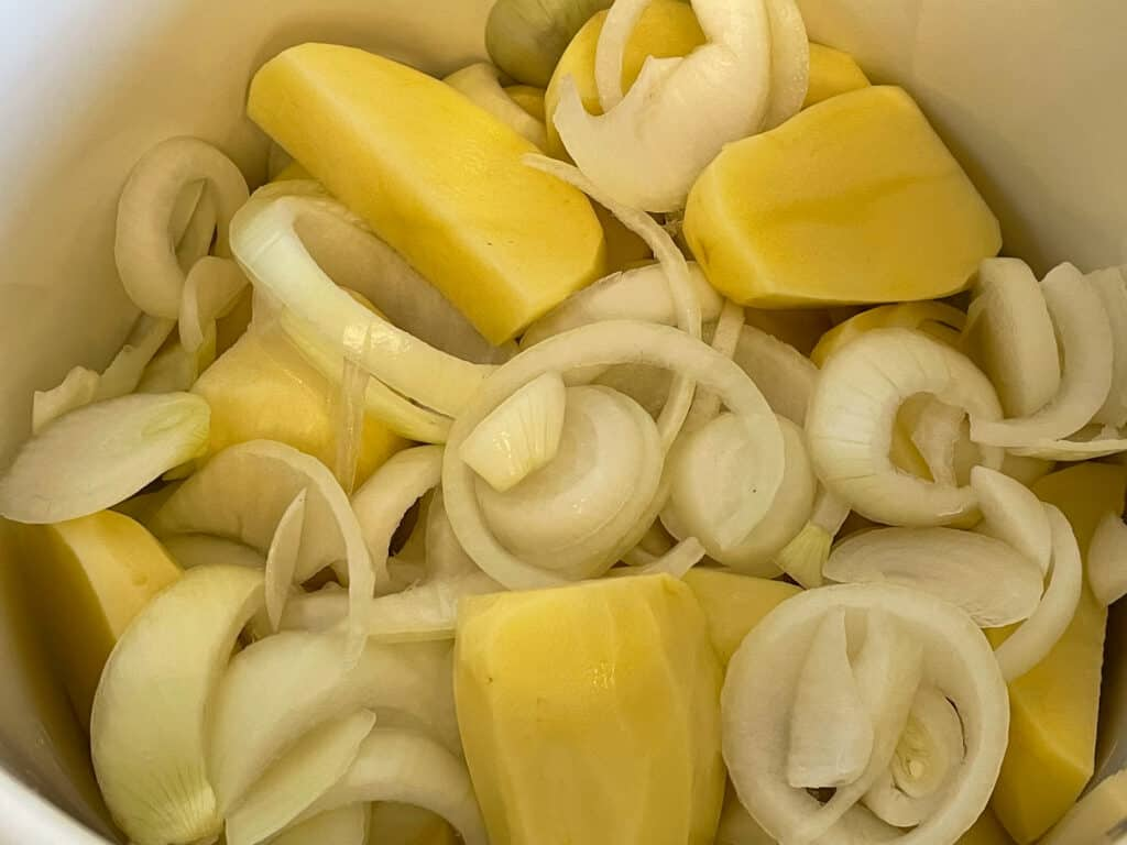 layers of onion and potato in stock pot.