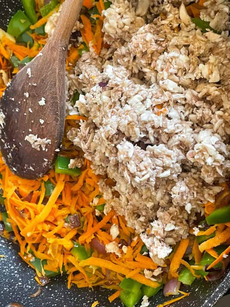 mushrooms fine chopped and added to casserole pan with grated carrots.