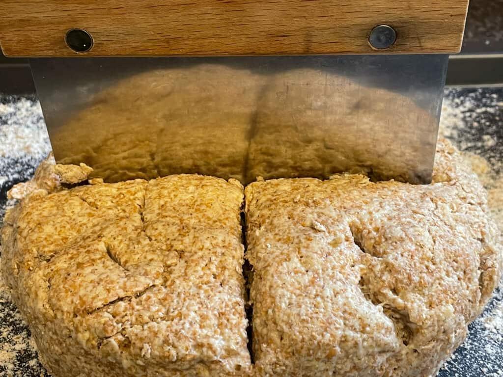 Bread dough slice on top of bread dough.