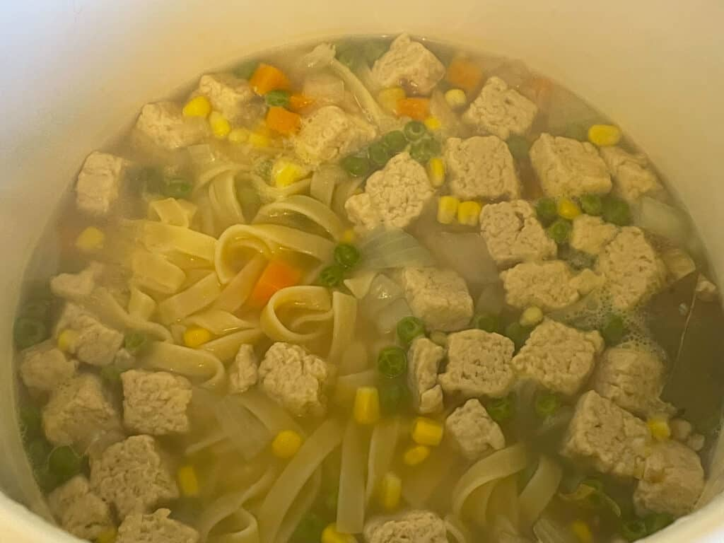 noodle soup cooking in pan.