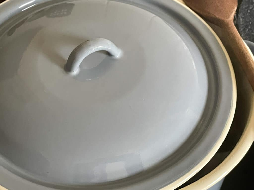 Blue lid added to soup pan.