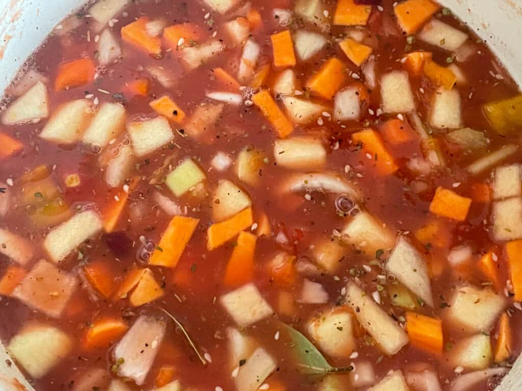 Veggie stock added to soup pan.