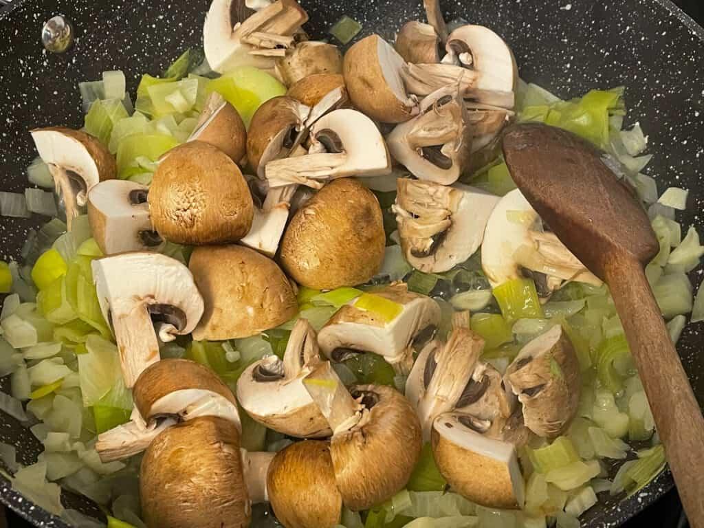 Mushrooms added to skillet.