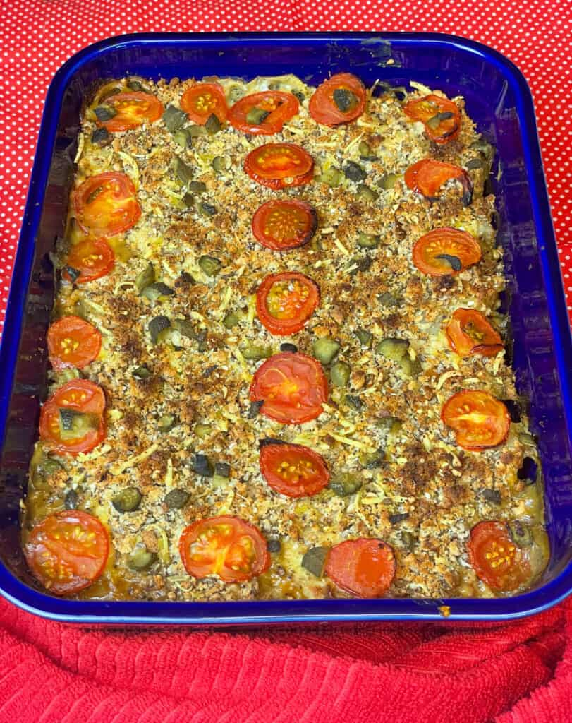 Vegan Hamburger Casserole in blue dish with red background.
